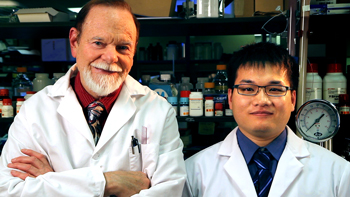 Dr. James F. Hainfeld and Hui Huang in the Nanoprobes Laboratory.